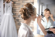 canvas print picture - Makeup artist preparing bride before her wedding in room