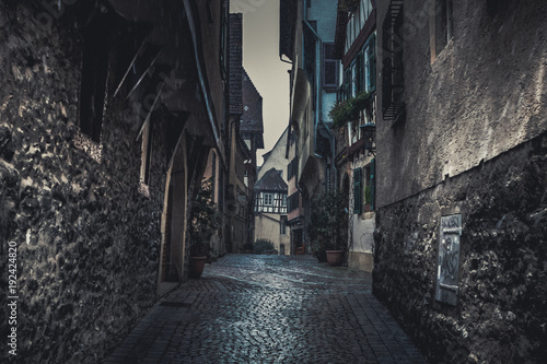 Fototapeta Cityscape with old, half-timbered buildings at winter in romantic medieval town