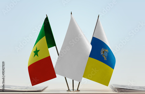 Deurstickers Canarische Eilanden Flags of Senegal and Canary Islands with a white flag in the middle