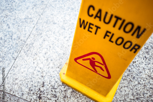 Fotografiet man slip on wet floor icon, yellow plastic stand signage for customer to walk ca