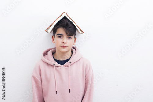 Fotografie, Obraz adolescent or preadolescent student with book on white background