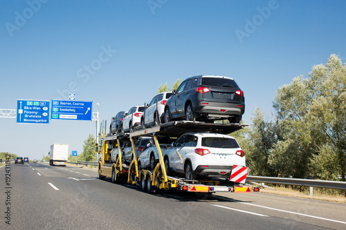 Stampa su Tela Car carrier trailer with new cars for sale on bunk platform