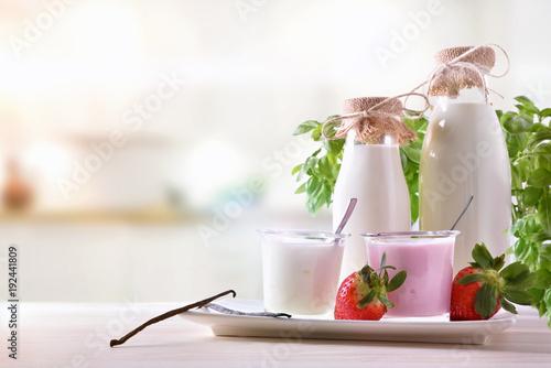 Fototapeta Strawberry and natural yogurt on wooden table front obraz
