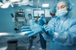 doctor wearing medical gloves in operating room