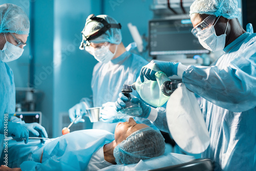 african american anesthetist holding oxygen mask above patient Canvas Print