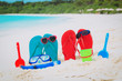slippers, toys and diving mask at beach