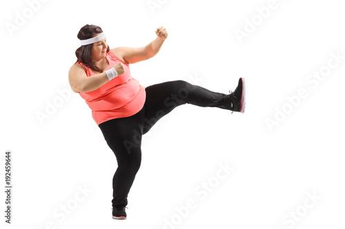 Photo  Overweight woman kicking