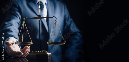 Weight scale of justice, lawyer in background Fototapeta