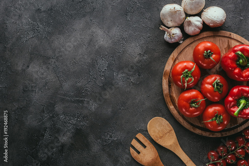 Photo top view of different raw vegetables for pizza topping on concrete surface
