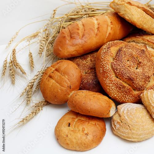 Keuken foto achterwand Bakkerij different bread with ears on a white background.