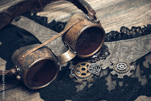 A beautiful still-life in the steampunk style with protective goggles and accessories of women's clothing Canvas Print