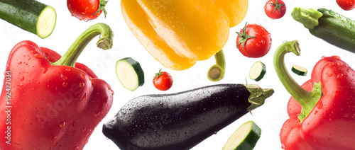 Spoed Foto op Canvas Verse groenten Fresh healthy vegetables falling on white background, healthy eating concept