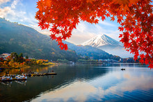 Mount Fuji At Lake Kawaguchiko With Sunrise In The Morning And Autumn Colorful Red Maple Leaf.