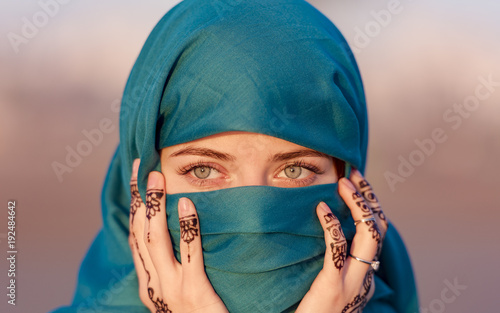 Fototapeta Arabian Moroccan woman with blue scarf in Morocco obraz