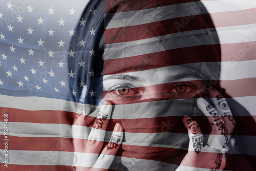 Photo Refugee woman and American flag, conceptual picture