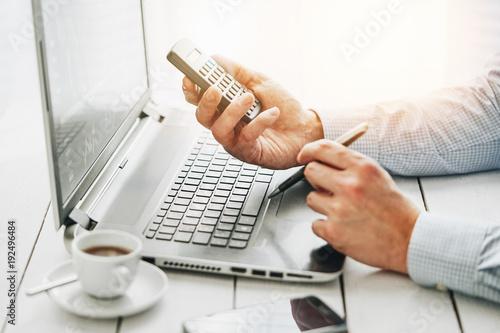 Fototapeta businessman using a calculator obraz