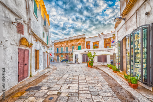 Alleyway in old white town Ostuni, Puglia, Italy