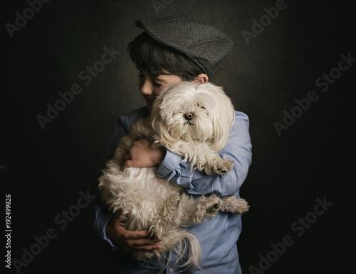 niño abrazando a su perro Canvas Print