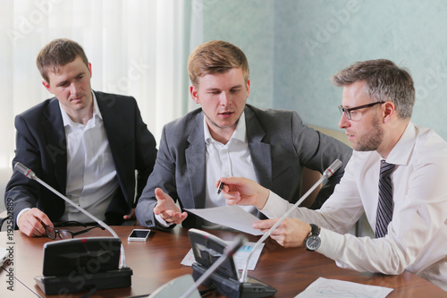 Fototapeta three businessmen at the meeting to communicate, Business people working together obraz na płótnie