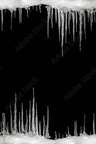 icicles on a black background space for text template for design
