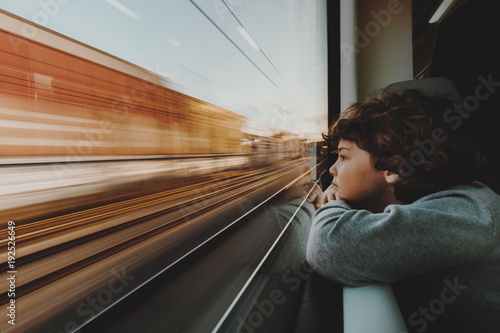 Boy Looking Through Train Window