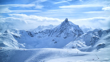 Alpine Mountain Peaks In Clouds, Ski Slopes, Off Piste Trails In Winter Sport Resort Of Courchevel, 3 Valleys, France .