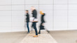 blurred anonymous people walking in a floor