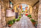 Fototapeta Uliczki - Alleyway in old white town Bari