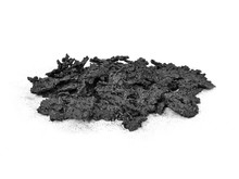 Pile Of Creosote Accumulation That Was Removed From A Wood Stove Chimney During Stove Pipe Cleaning.