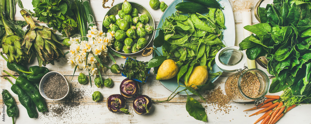 Fototapety, obrazy: Spring healthy vegan food cooking ingredients. Flat-lay of vegetables, fruit, seeds, sprouts, flowers, greens over white wooden background, top view. Clean eating, diet food concept