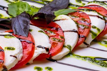 Fototapeta Caprese salad with mozzarella and tomato