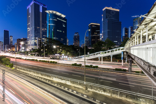 Deurstickers Brooklyn Bridge Traffic rushing in Jakarta business district at night in Indonesia capital city
