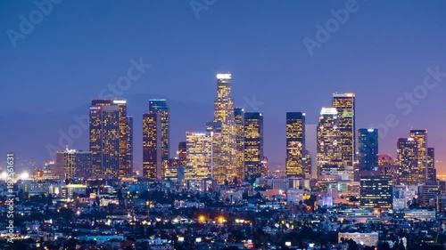 Sticker - Zoom in downtown Los Angeles skyline change dusk night city. 4K UHD Timelapse