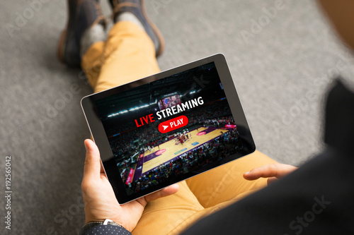 Man watching sports on live streaming online service Fototapet