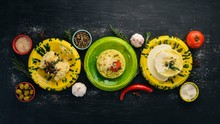 A Set Of Side Dishes. Risotto, Couscous, Pudding On A Wooden Background. Top View. Free Space For Your Text.