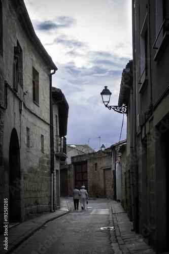 Adult couple walking on street