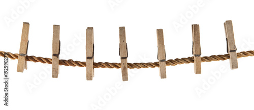 Fotografie, Obraz  wooden clothespin on a rope isolated on white background closeup