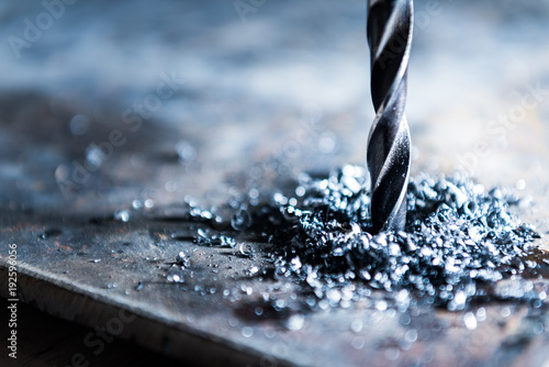 Obraz close up of drilling a hole with metal shavings - fototapety do salonu