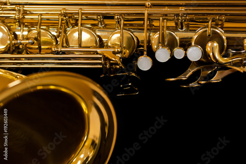 Fragment of saxophone on a black background Wallpaper Mural