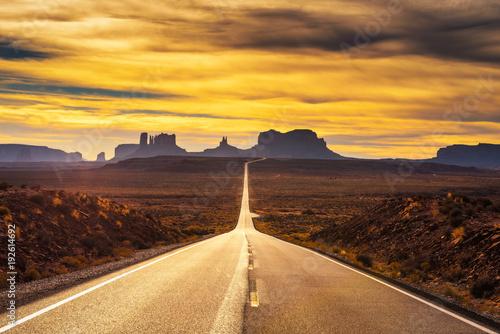 obraz dibond Desert road leading to Monument Valley at sunset