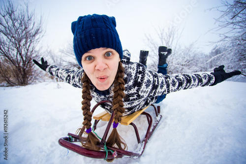 woman sledding funny oman play outdoors in snow - Christmas Vacation Sled