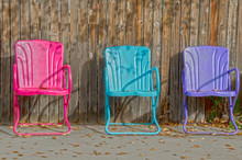 Three Colorful Empty Lawn Chairs