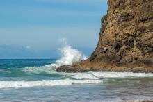 Man Climbing Oceanside Cliff W...