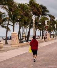 Woman Walks On Boardwalk