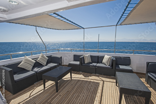Carta da parati Table and chairs on deck of a luxury motor yacht