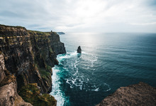 A Sea Stack Stands Out From The Irish Cliffs Of Moher