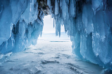 Winter Landscape, Frozen Ice Cave With Bright Sunlight From Way Out At Lake Baikal In Irkutsk, Russia