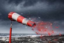 Damaged Windsock And Stormy Sea - Storm Warning