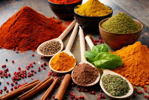 Fototapety, obrazy: Variety of spices on kitchen table