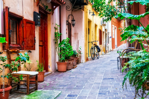 Photo Stands Narrow alley traditioanl colorful narrown streets of Greek town Rethymno, Crete island